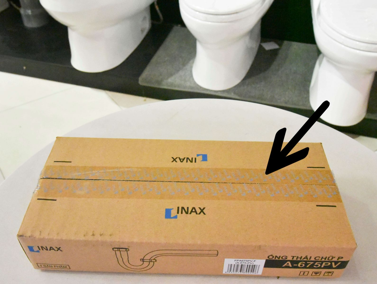 Băng kéo dán Inax có in logo bạc - tem Inax chống giả